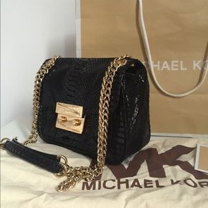 Michael Kors snakeskin crossbody bag. Like new!